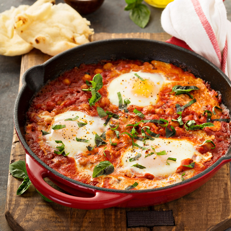 Shakshuka with chickpeas in a skillet Stock Photo