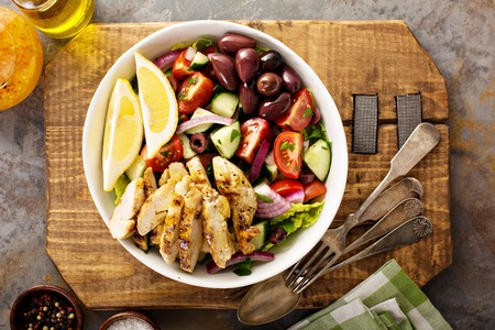 Grilled chicken and fresh vegetables chopped salad