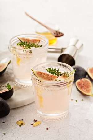 Pink fig cocktail with honey and thyme