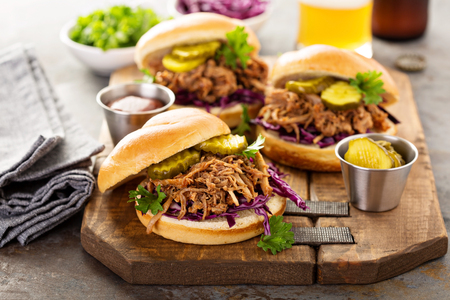 Pulled pork sandwiches with cabbage and pickles Stock Photo