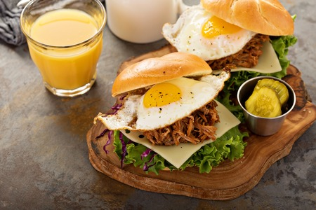 Pulled pork breakfast sandwiches with fried egg