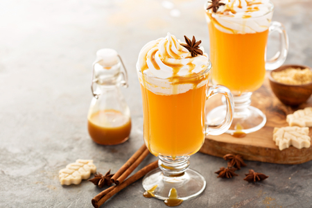 Hot spicy cider with whipped topping