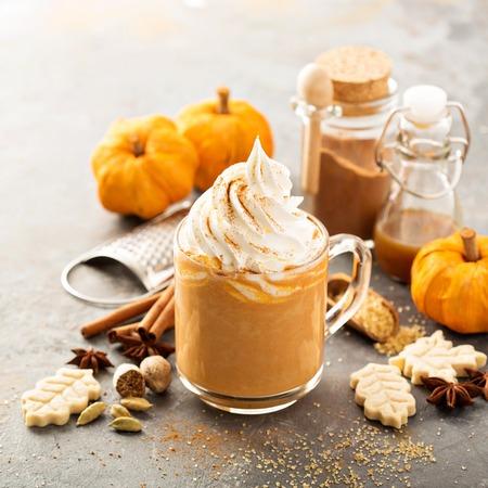 Pumpkin spice latte in a glass mug 写真素材