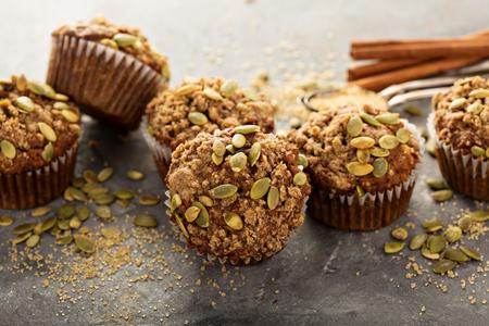 Healthy pumpkin muffins with fall spices and pumpkin seeds Standard-Bild