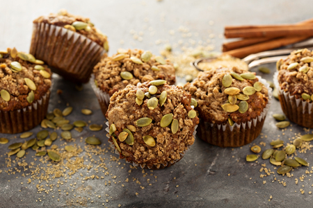 Healthy pumpkin muffins with fall spices and pumpkin seeds Imagens