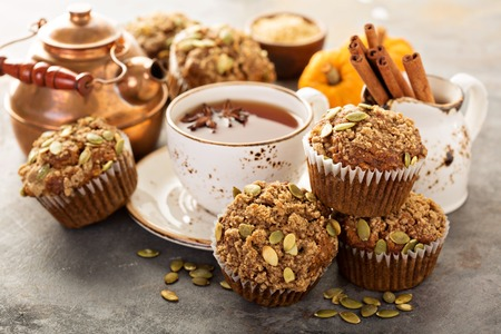 Healthy pumpkin muffins with fall spices and pumpkin seeds Stock Photo