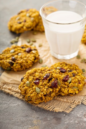 Breakfast oatmeal cookies with pumpkin puree, cranberry and seeds with milk