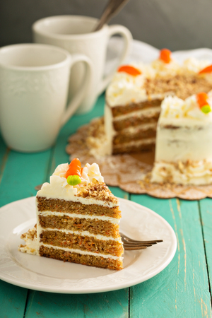 Piece of carrot cake with cream cheese frosting