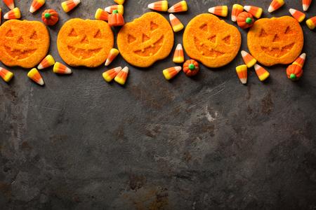 Halloween pumpkin cookies and candy Stock Photo