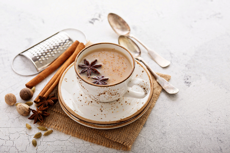 Masala tea in cup with winter spices