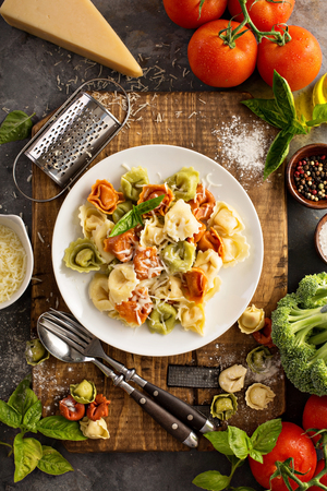 tortellini: Red, white and green tortellini with vegetables and cheese
