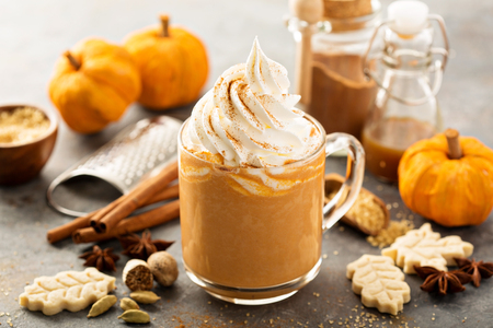 Pumpkin spice latte in a glass mug
