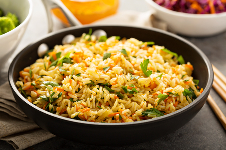 Fried rice with vegetables and steamed broccoli Standard-Bild