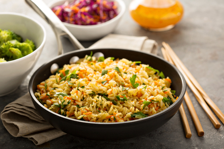 Fried rice with vegetables, steamed broccoli and cole slaw