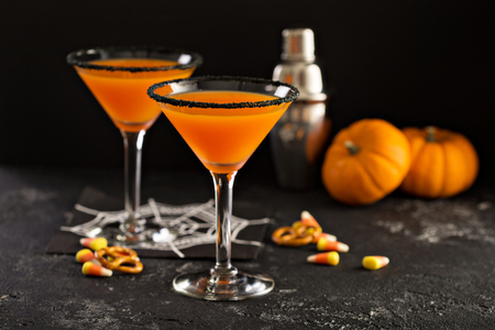 Halloween or fall cocktail pumpkintini with black rim, pumpkin martini