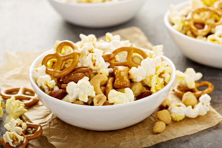 Homemade trail mix with popcorn, pretzels and nuts Stock Photo