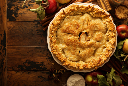 Apple pie decorated with fall leaves Фото со стока