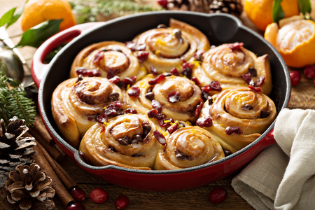 Orange and cranberry cinnamon rolls Фото со стока