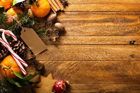 オレンジ、キャンディの杖の装飾とクリスマスの背景 写真素材