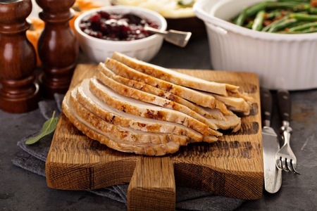 Sliced roasted turkey breast for Thanksgiving or Christmas Foto de archivo