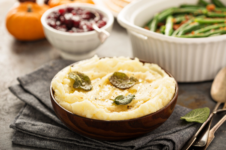 Mashed potatoes with butter and sage Imagens
