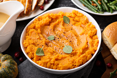 Mashed sweet potatoes on Thanksgiving table