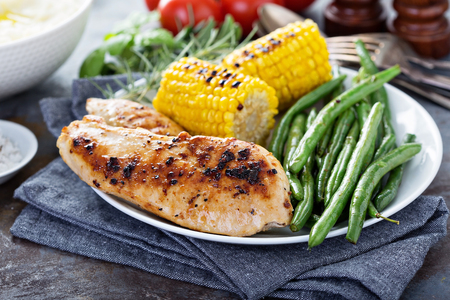 Big summer dinner with grilled chicken, green beans , corn on cob and mashed potatoes
