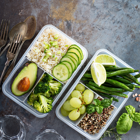 Vegan green meal prep containers with rice and vegetables