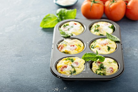 Healthy egg muffins, mini frittatas with tomatoes