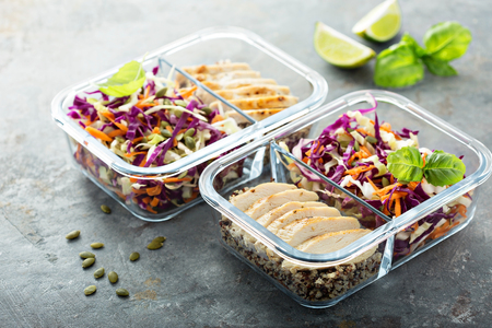 Healthy meal prep containers with quinoa and chicken