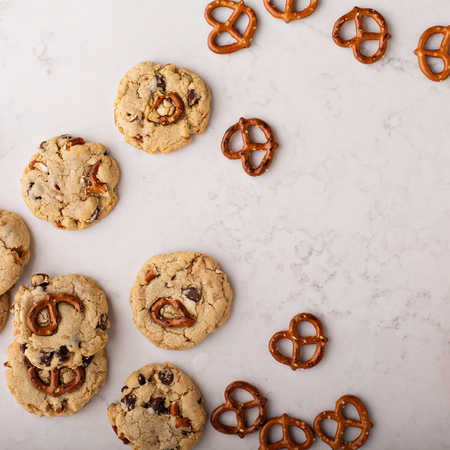 Chocolate chips and pretzels cookies on a marble table Stock Photo