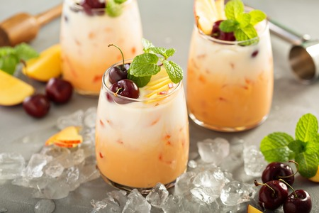 Summer refreshing drink, cherry and peach coconut milk cocktail with ice Stok Fotoğraf