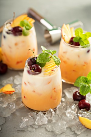 Summer refreshing drink, cherry and peach coconut milk cocktail with ice Stok Fotoğraf - 94423924