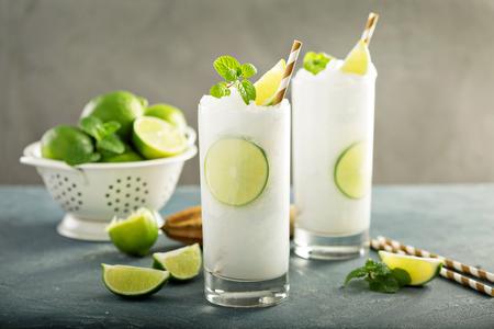 Refreshing summer drink lime frozen cooler or slushie Foto de archivo