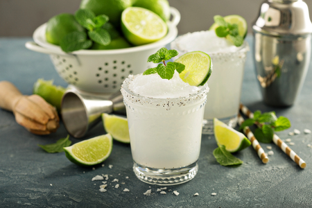 Frozen lime and mint margarita in glasses