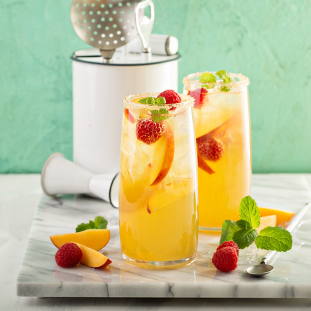 Colorful refreshing cold summer drink with peaches