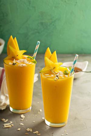 Mango smoothie with honey and coconut 写真素材