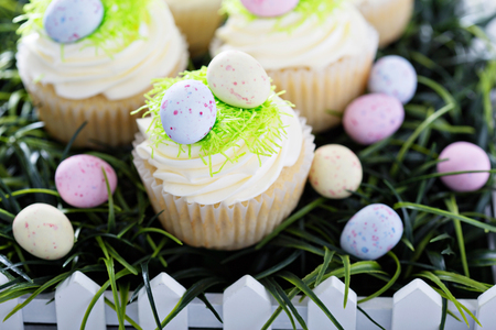 Easter vanilla cupcakes with cream cheese frosting and egg candy