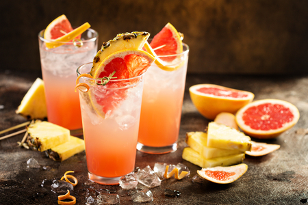 Grapefruit and pineapple cocktail or mocktail, refreshing drink with sparkling water Stock Photo - 94474214