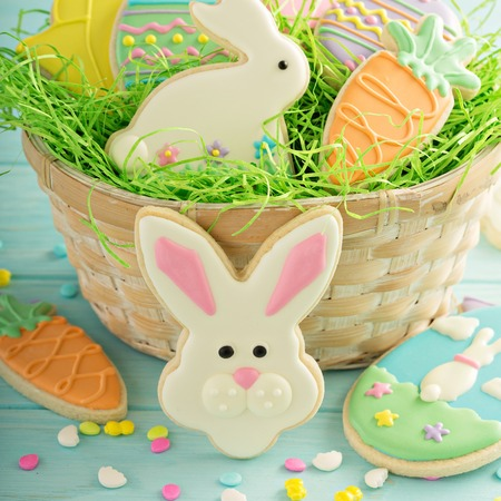 Easter cookies on blue table Stock Photo - 96533375
