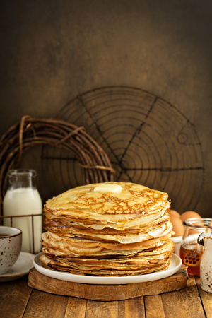 Big stack of homemade crepes or thin crepes