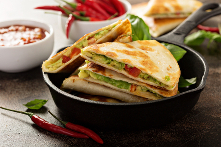 Vegan quesadillas with avocado and red peppers