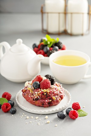 Berry shortcake donuts with tea Stock Photo