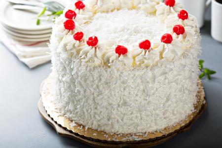 Coconut cake with maraschino cherries 스톡 콘텐츠