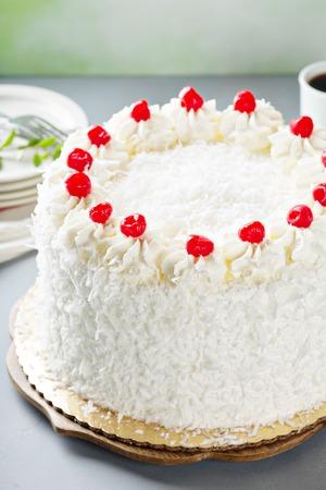 Coconut cake with maraschino cherries Stock Photo