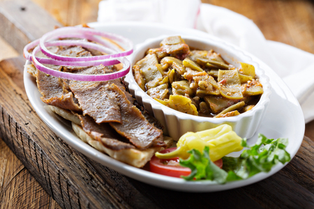 Gyro plate with meat on a pita Stock Photo - 97968736