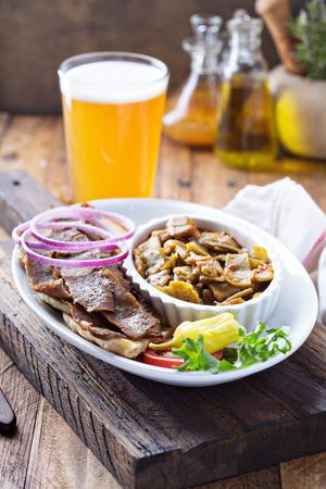 Gyro plate with meat on a pita