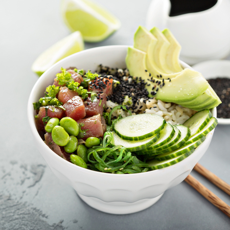 Poke bowl with raw tuna, rice and vegetables