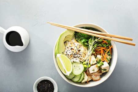 Poke bowl with silken tofu, rice and vegetables
