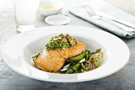Grilled salmon on the bed of sauteed greens